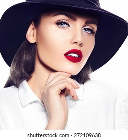 High fashion look.glamor closeup portrait of beautiful sexy stylish brunette business young woman model with bright makeup with red lips in white coat jacket in french hat
