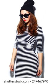 High fashion look.glamor stylish beautiful  young happy smiling woman model with red lips  in zebra dress in black beanie