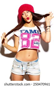 High fashion look.glamor stylish beautiful  young woman model with red lips  in summer bright colorful  hipster cloth in red beanie