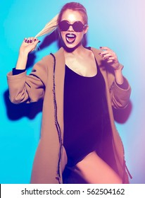 High fashion look.glamor stylish funny sexy beautiful young blond woman model in summer bright hipster cloth on blue background