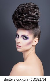 High Fashion Model Girl with hairstyle and bright make up. Beauty woman with glamour hairdo hair style, stylish makeup.