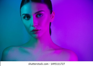 High Fashion model girl in neon lights posing in studio, portrait of beautiful woman, trendy glowing make-up. Art design colorful make up.