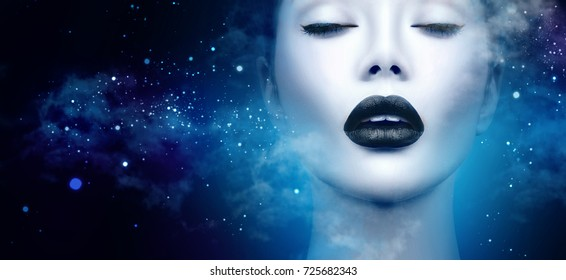 High Fashion Model Girl Portrait with Trendy gothic Black Make up, dark space background with clouds and stars. Halloween Vampire fantasy Woman portrait with black matte lips  deep blue background.