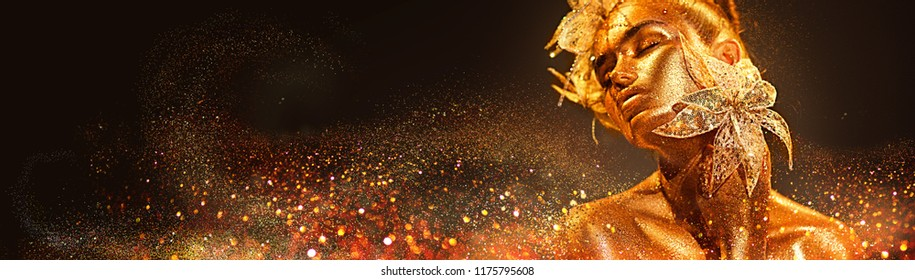 High Fashion model woman with bright golden sparkles on skin posing, fantasy flower, portrait of beautiful girl glowing make-up. Art design gold sequins make up. Glitter glowing golden skin, jewellery