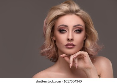 High fashion model woman portrait. Beauty girl with blonde hair and glamour makeup. Hairstyle. Beautiful lady with Short Blond hair.