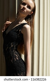 High fashion portrait of beautiful sexual woman model in black lacy dress. Outdoors trendy look