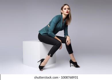 high fashion portrait of young elegant woman. Suede jacket, skinny black pants, black heels shoes