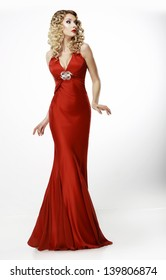 High Fashion. Shapely Blonde in Silk Evening Red Gown. Femininity