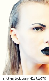 High fashion vogue style, manicure, cosmetics and make-up. Studio portrait of female caucasian young blonde model with black lipstick. Isolated on white background. Studio portrait. Toned