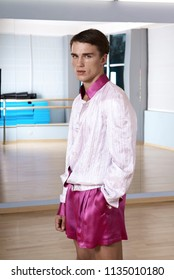 High fashion young sexy man in pink shorts and a white jacket.