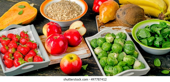 High Fiber Foods on dark rustic wooden table.