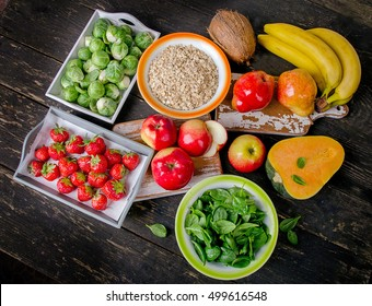 High Fiber Foods on dark wooden table. Top view