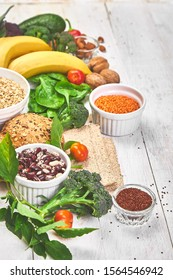 High Fiber Foods on white wooden background, Healthy balanced dieting concept. Top view, flat lay, copy space.