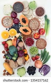 High fibre health food with fresh fruit & vegetables, grains, legumes, seeds, nuts and whole grain crackers, bread rolls, also high in omega 3, anthocyanins, antioxidants & vitamins.