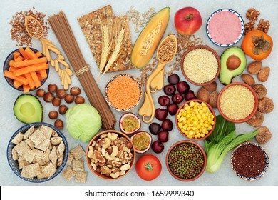 High fibre vegan health food with a large variety of foods high in antioxidants, omega 3, vitamins & protein with low GI levels for diabetics. Helps to lower blood pressure & cholesterol. Flat lay.