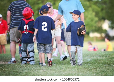 High Five line after a children's  baseball game