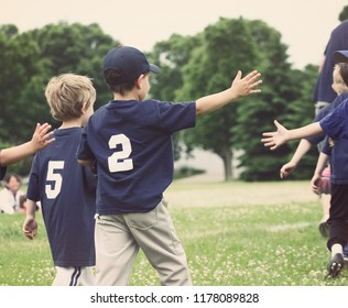 High Five line after a childs tee ball game, shallow focus