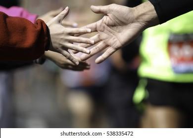 High five in a marathon