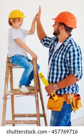high five! Well done, dude! Father and son repair the house