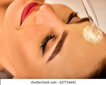 High frequency machine in spa salon. Young woman receiving electric darsonval facial massage after procedure at beauty room close up. Modern technologies and methods of rejuvenation.