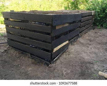 high garden bed of wooden pallets