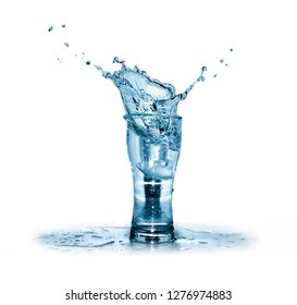 High glass with cold splashing water isolated on white background