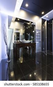 High gloss modern bathroom with black floor and white wall