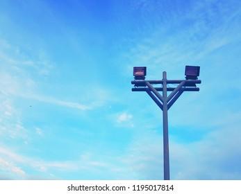 high halogen lamp eletricity on post blue sky