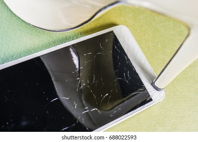 High heel crushing a mobile phone.
