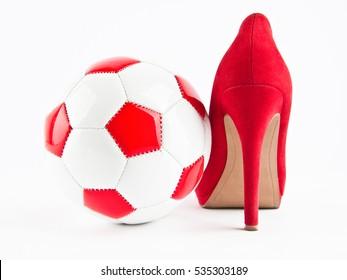 High heel shoe and soccer ball
