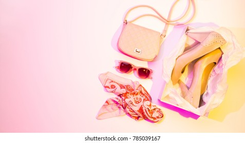 High heels, handbag, scarf and sunglasses - women's spring fashion accessories. Colorful (multicolor tonal transitions) background. Banner layout with free copy (text) space.