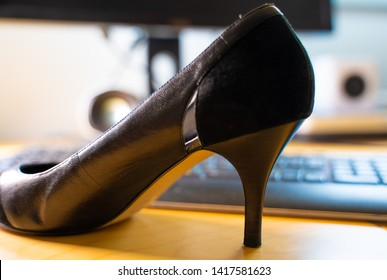 High heels on a table at workplace in office. Suitable for concepts like the japaneese kuToo movement from workplaces that require the footwear, businesswoman at work, high heels or stiletto tyrany or