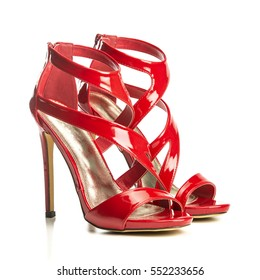 high heels sandals in shiny red patent leather with small platform sole and ankle strap