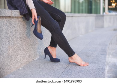 High heels shoe feet pain. Closeup of woman barefoot with painful toes