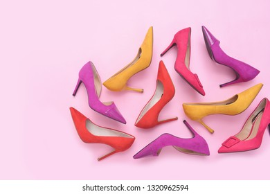 high heels. Top view different colors of high heels isolated pink background. Fashion and beauty concept. Footwear for women