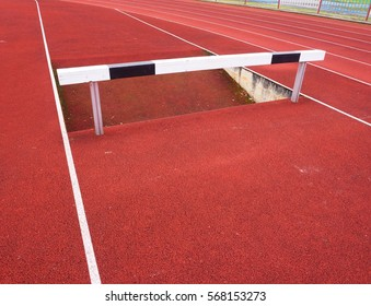 High hurdle. Hurdle track running  lane. Wooden Hurdle On red  High School Track