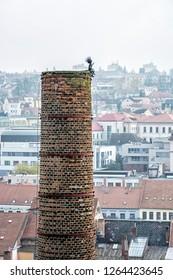 High industrial chimney with funny figure in the center of Trebic, Czech republic. Architectural theme. Travel destination.