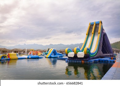 High inflatable water slider on the river, Waterpark with a beautiful view in the background