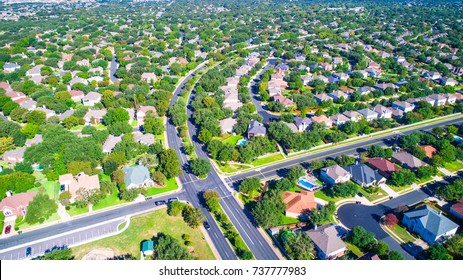 High intersection cross roads Round Rock , Texas , USA Suburb growing outside of Austin high aerial drone view green end of summer colorful morning Millions of Homes vast Neighborhood Suburbia