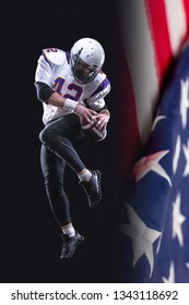 High jump of American Football Player, isolated on black background with US flag