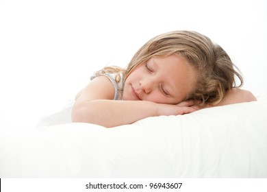High key Close up portrait  of cute little girl sleeping. Isolated on white background.