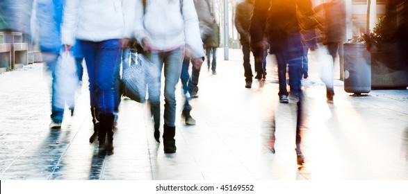 High key image of a group of high school students walking towards the camera