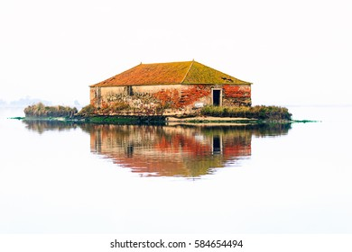 High key landscape of a abandon house on the Aveiro river in Portugal