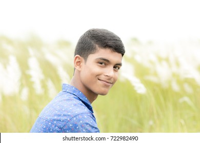 High key outdoor portrait of a good looking 18 year old Indian male model  with a