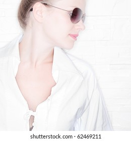High Key Portrait of a stylish girl with sunglasses