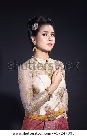 ba432c3f0 High Lady wearing traditional Thai dress with identity Southeast Asia  culture Sawasdee, Welcome expression, Happy asian woman with blank copy  space, ...