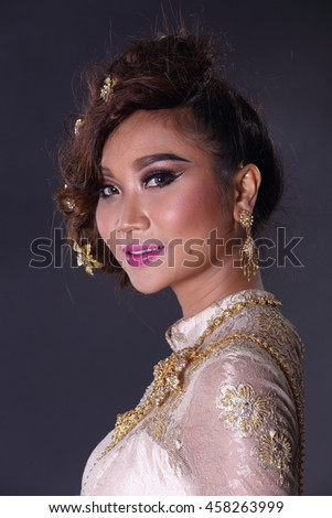 89c2bfc78 High Lady wearing traditional Thai dress with identity Southeast Asia  culture Sawasdee, Welcome expression, Happy asian woman, studio lighting -  Image