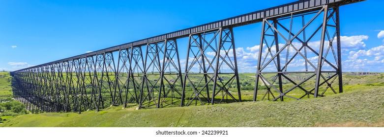 The High Level Bridge in Lethbridge, Alberta, Canada. The bridge is the longest and highest trestle bridge in the world soaring above the Oldman River.