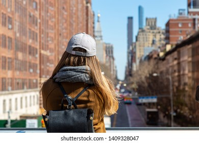 The High Line NYC Park view. Young tourist looking at Manhattan panorama