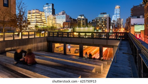 The High Line at twilight with a view on 10th Avenue with skyscrapers and building illumination. Chelsea, Manhattan, new York City, USA